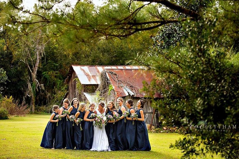 Lindsey and her bridesmaids on north side of home in front of barn built in late 1800s.