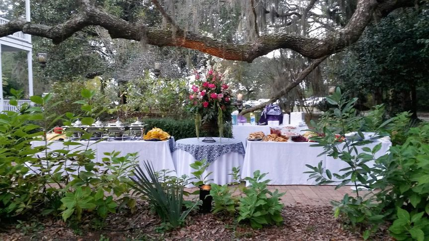 Beautiful buffet table on front walkway under 120 year old Live Oak trees.  #SweetSouthernScratch