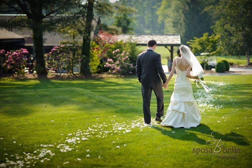 Newlyweds walk down the petal path