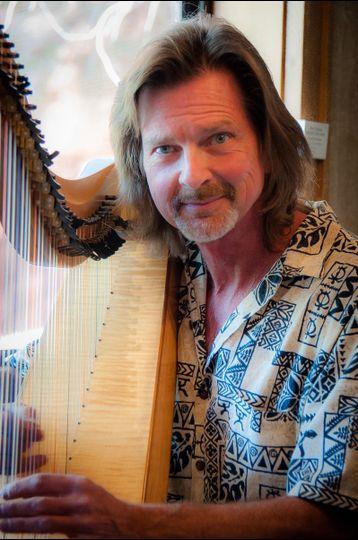 Oman Ken Harp - Guitar