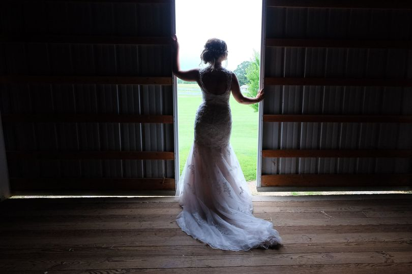 A stunning Rockford IL Bride at a local barn. Wedding photography by Jay Bryant