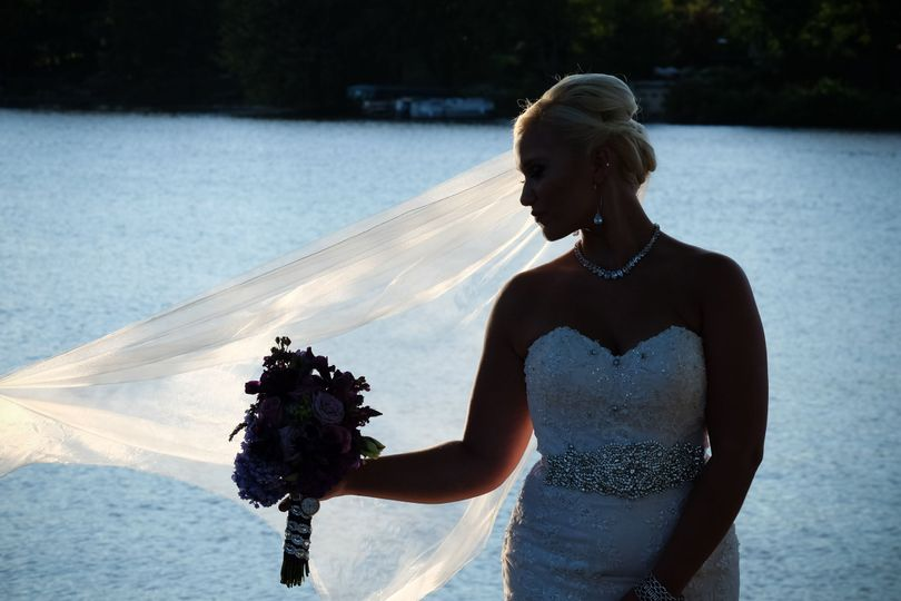 A stunning Rockford IL Bride along the Rock River.  Wedding photography by Jay Bryant