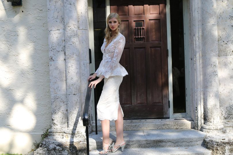 Two pieces wedding dress, lace knee length skirt with a beautiful long sleeves jacket.