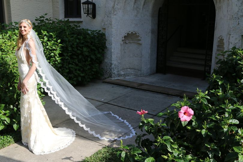 Beautiful lace beaded low back wedding gown. long cathedral lace veil.