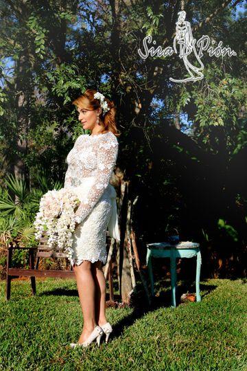Beautiful knee length long sleeves lace wedding dress.