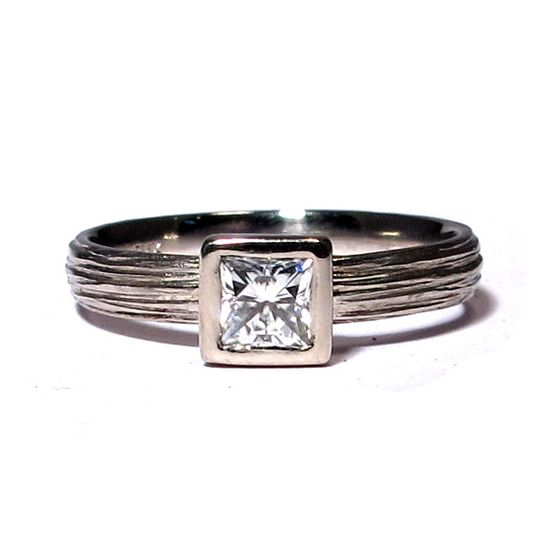 This textured Palladium band features a 4mm princess cut Moissanite, a great alternative to diamonds...