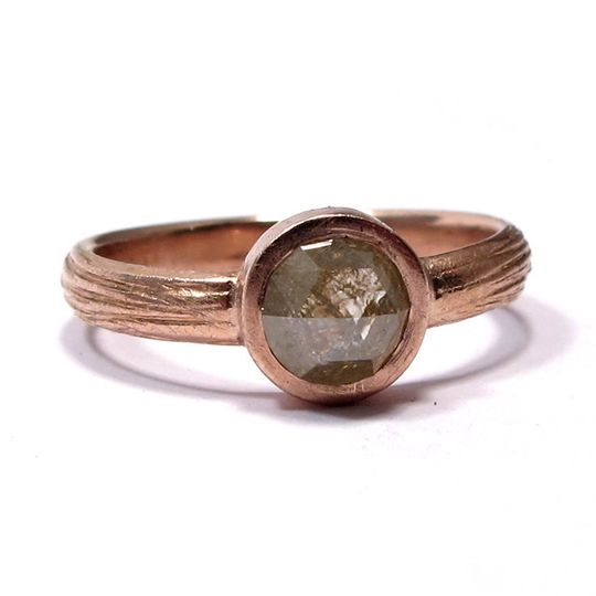 This textured rose gold band features a 1 carat rose cut diamond, slightly yellow and golden in...