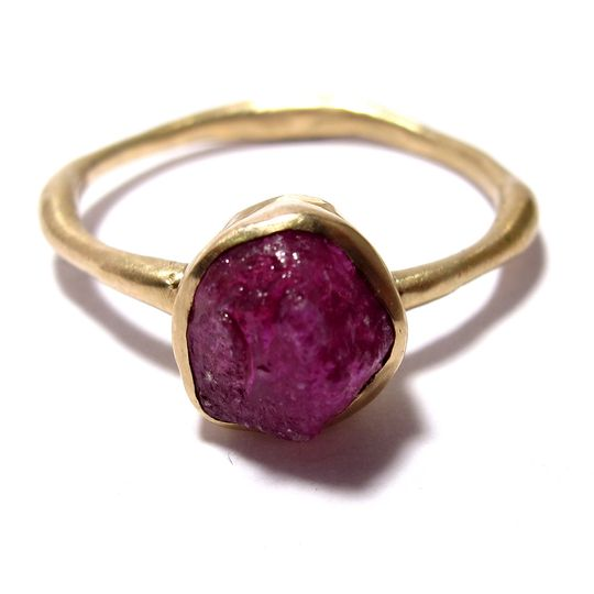 This organically shaped yellow gold band features a 1.2 carat rough ruby. Completely unique.
