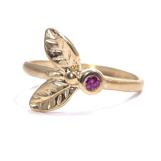 This organic leafy yellow gold ring features a bezel-set  .02 carat ruby.