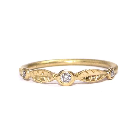 This leafy organic wedding band features three diamonds and comes in both yellow and white gold.