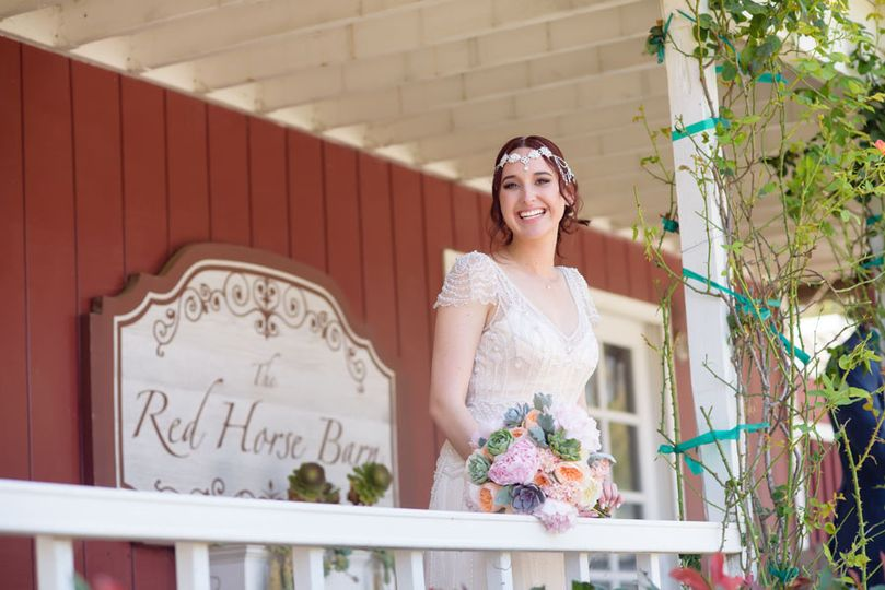 Bride at red horse barn