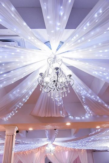 Ceiling drapery and chandelier