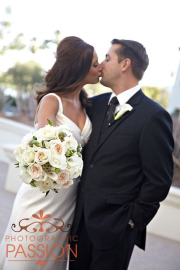 Nadine's Wedding was filmed for the TLC show Four Weddings. Nadine carried luscious cream garden...