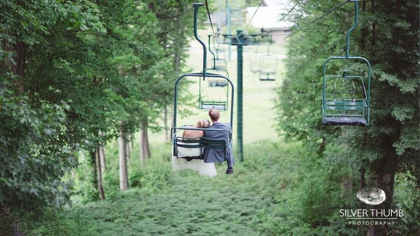 Couple riding chairlift