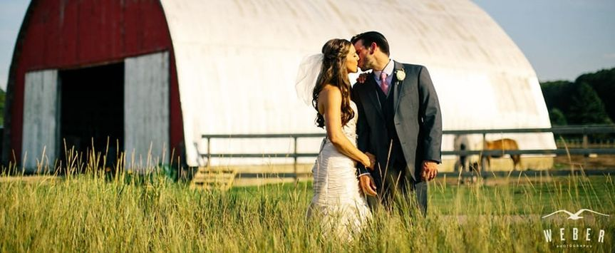 kissing in front of Barn