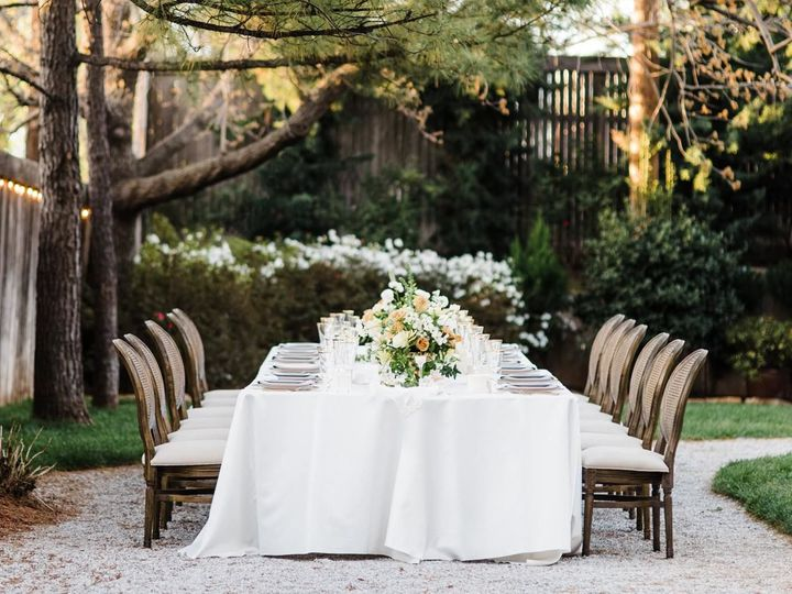 This intimate table set for twelve, styled by Ever Something Events and Floral Design. With chairs...