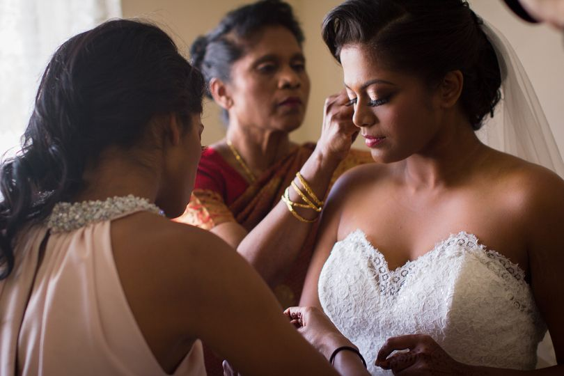 The Mother of the Bride & the Maid of Honor helping the Bride prepare for the ceremony.