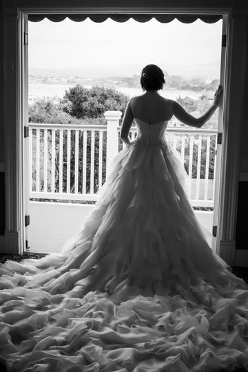 We love this epic wedding dress and the view from the balcony at The Perry House in Monterey.