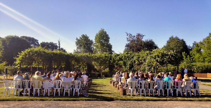 A view from the back of the ceremony at The Oregon Gardens. This is a minimal setup. We used a...