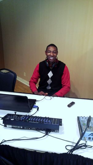 DJ Harris posing for the camera while setting up for the reception. Circa 2016.