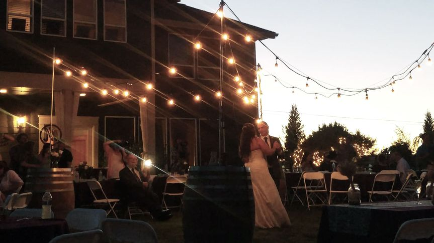 This is a photo taken from the DJ booth at an outdoor wedding at a private home venue. The first...