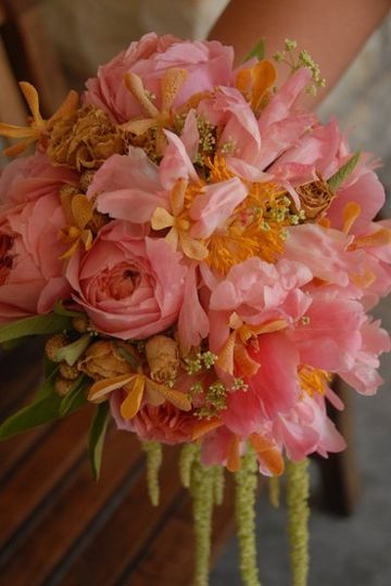 Bride's bouquet of coral peonies and garden roses, golden orange mokara orchids, Queen Anne's lace,...