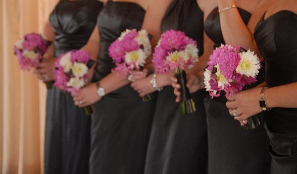 Groom's boutonniere of yellow and orange mokara orchids and pink spray roses.