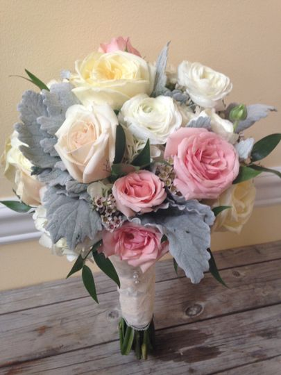 Shades of blush to creams with added silvery foliage of dusty miller