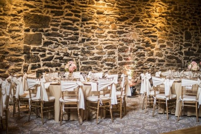 The wooden tables and chairs | Stuart G. Sanft Photography