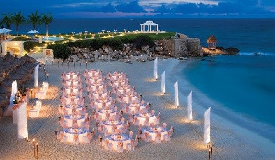 Aerial view of a beach front wedding