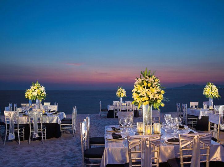 Candlelit beachfront dinner setup
