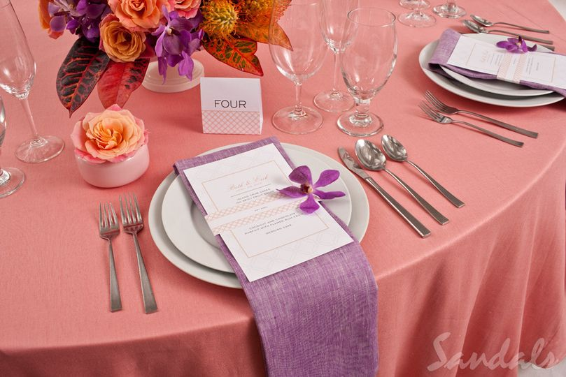 Table setting with pink and purple decor