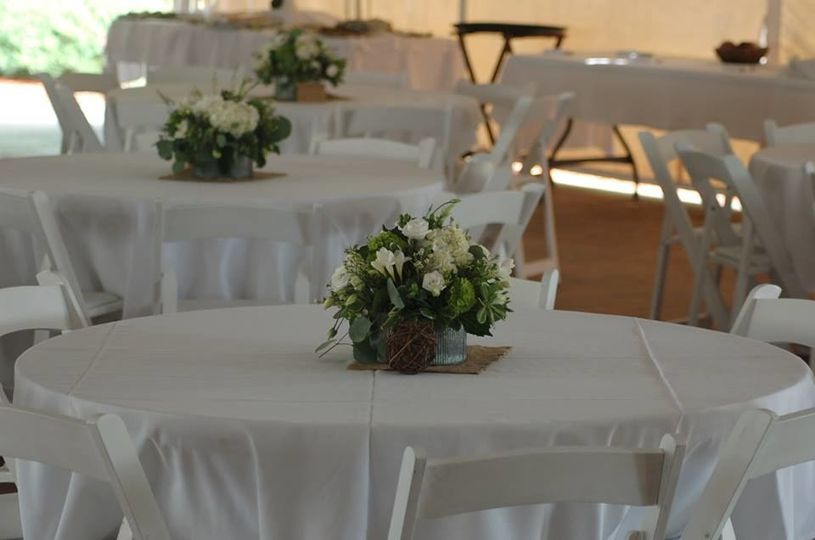 Simple & beautiful center pieces in the Garden Tent.