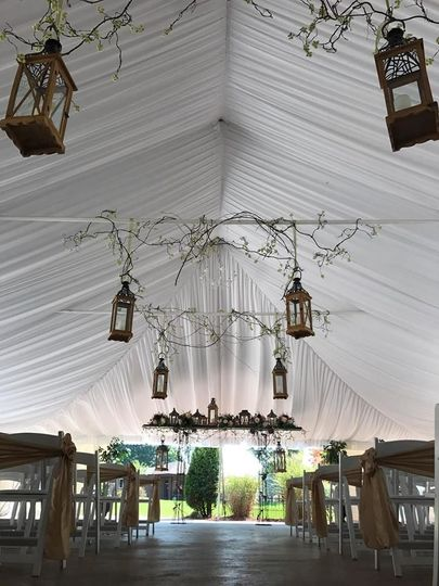 You can have your ceremony underneath the beautiful white draped ceilings in the Garden Tent.