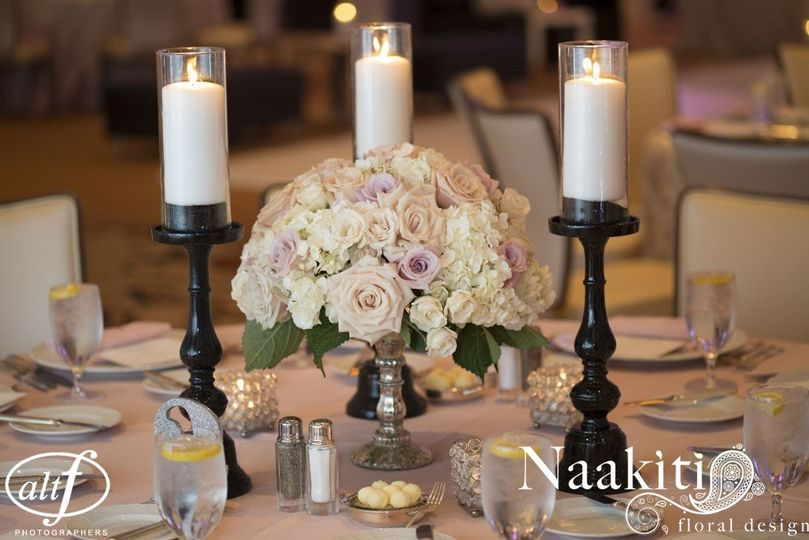 White and pink floral centerpiece and candles