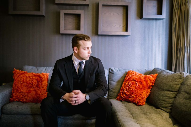 Groom sitting in the lounge area