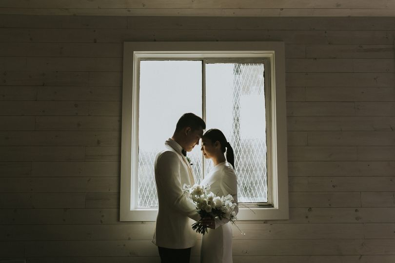 Newlyweds by the window