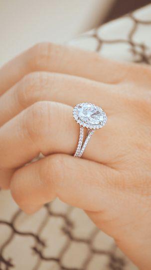 Oval halo split diamond band engagement ring