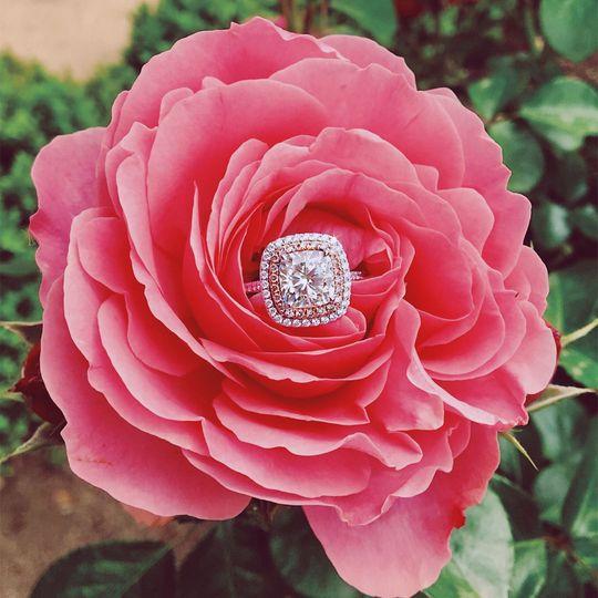 Custom cushion shaped halo diamond engagement ring