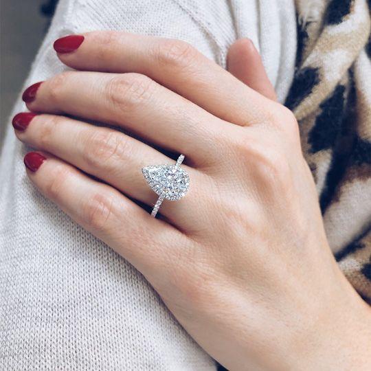 Pear shaped halo diamond ring