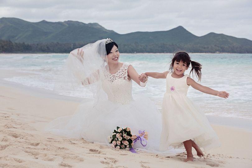 bride flower girl beach wedding