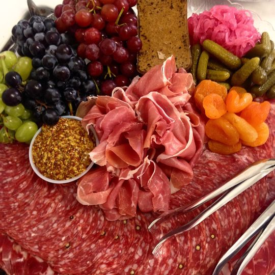 Chef's selection of charcuterie with pickled vegetables and whole grain mustard