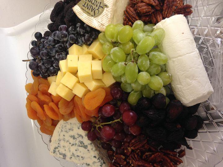 Artisan cheese platter with seasonal fruit