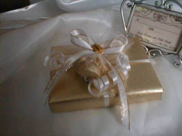 """Our """"Premium"""" Wrapping Package in Gold paper with attachments."""