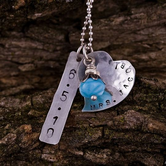 This sweet necklace is perfect for the bride-to-be or newly married. A sterling silver heart and...