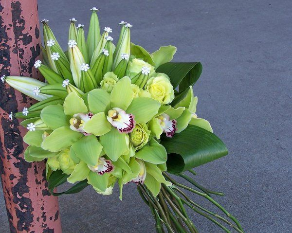 green orchid bouquet with Jewels