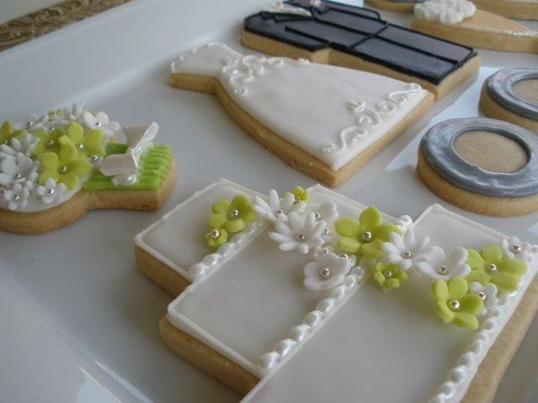 A wedding package, including a cake and bouquet with fondant flowers, a bride and groom, wedding...