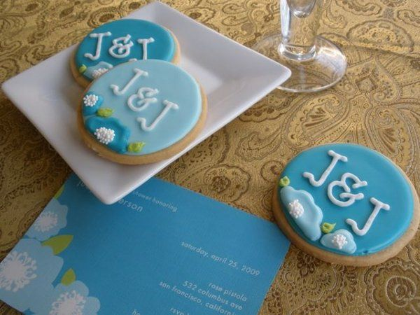Cookies customized with the bride and groom's initials, to match the wedding shower invitation.