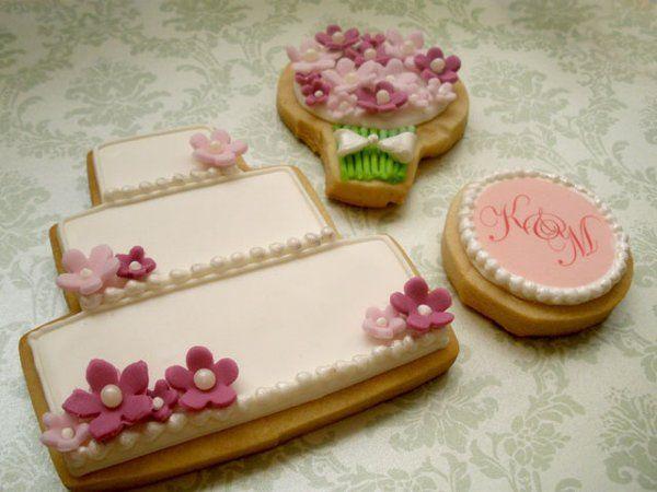 Wedding cake, bouquet, and monogram cookies.