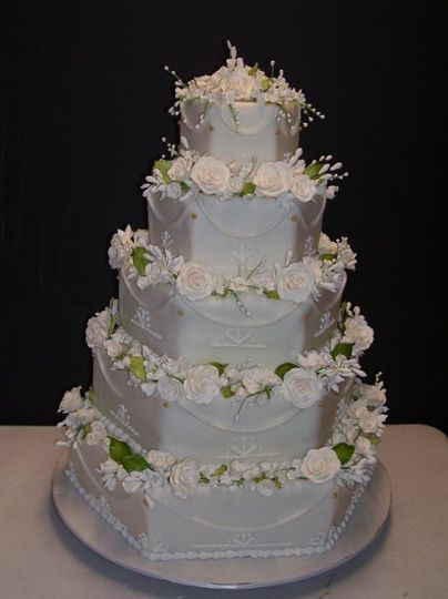This is a 5 tier stacked cake with Gumpaste Pearl Roses.